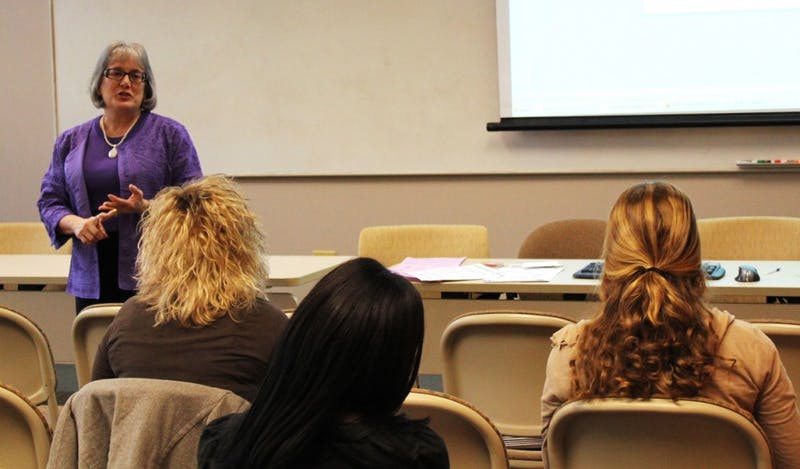 Sharon Jones, an employee for University Career Services, talks to students about teaching options for non-education majors on Monday.