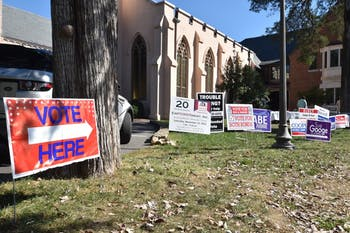 Students and local residents participate in early voting at Chapel of the Cross today.