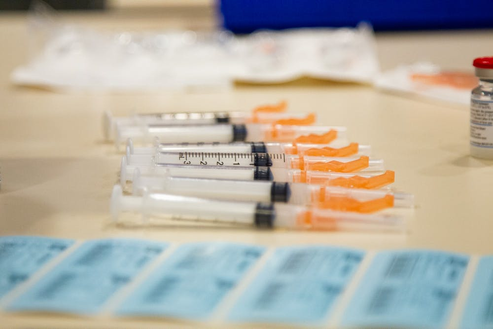 <p>Empty syringes wait to be prepared with a dose of the COVID-19 vaccine on Thursday, Jan. 21, 2021 in the Friday Center in Chapel Hill.</p>