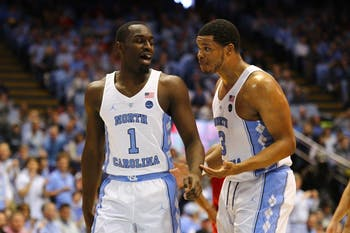 Junior forward Theo Pinson (1) strategizes with senior forward Kennedy Meeks (3) during the game against N.C. State.