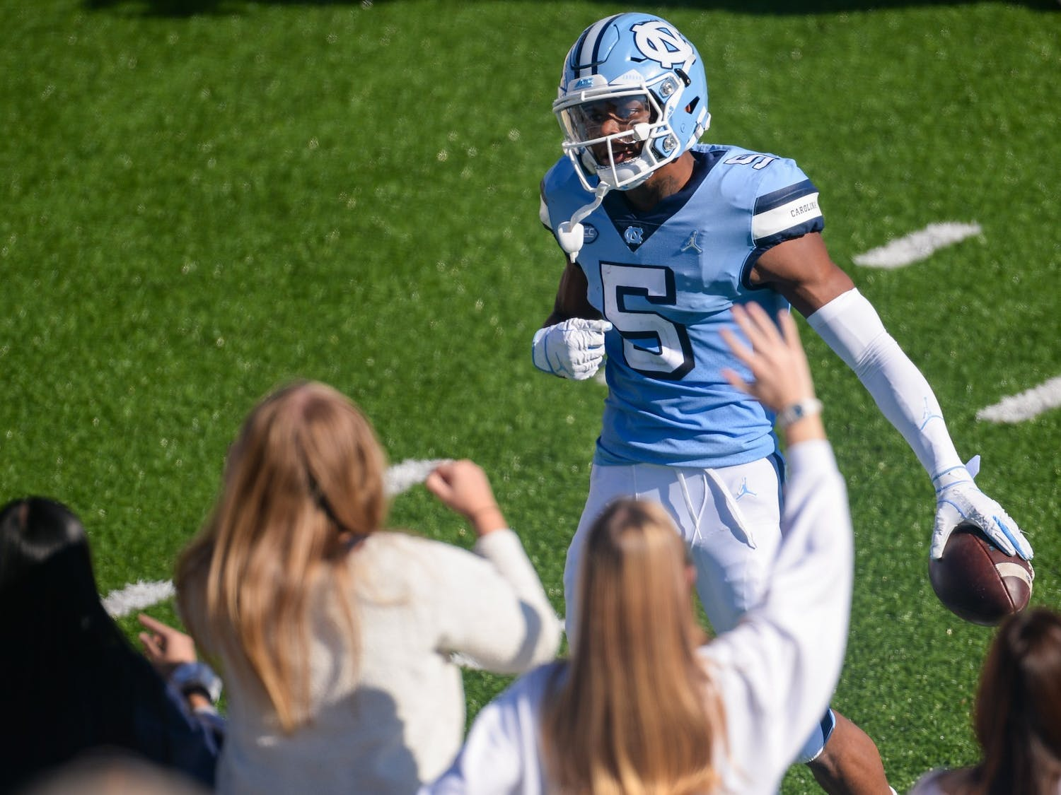 UNC senior wide receiver Dazz Newsome (5) celebrates a touchdown in front of the student section of Kenan Memorial Stadium during a game against Wake Forest on Saturday, Nov. 14, 2020. UNC beat Wake Forest 59-53.