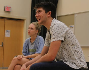 A day in the life of a CHIP: Senior Luke Miller (Business Administration and Economics Major and minor in cognitive science) looks on as his fellow CHIP members practice a skit. Bobby Decker (far left) (junior, English/Political Science Major) and Isabelle DeWitt (center) (senior, dramatic arts major) also look on.