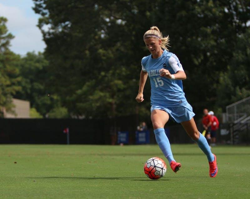 Midfielder Katie Bowen (15) dribbles down the sideline before a kick across goal.