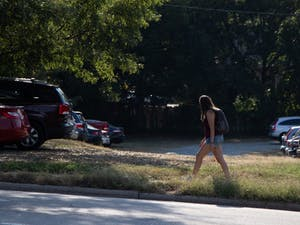 On Sunday, Sept. 29th 2019, a student walks by the vacant lot on Rosemary Street where a new hotel is planned to be built.