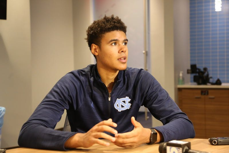 Guard Cam Johnson addresses the media after the Disaster Relief Jamboree on Nov. 5.