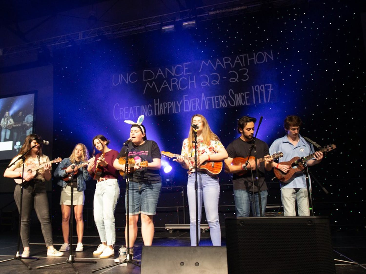 """Carolina For The Kids Foundation hosted the UNC Dance Marathon, a no-sitting, no-sleeping event comprised of over 2,000 students who remain standing for 24 hours at Fetzer Gym, on March 22 and March 23, 2019.  The event is a culmination of year-long fundraising efforts which raised $440,955.07. The money raised goes toward providing families with financial and emotional assistance at UNC Children's Hospital. Students who attended the marathon watched the basketball game between UNC and Iona, danced, watched musical performances and more. Students participated in the marathon for a various personal reasons, including having their own family members in the hospital or,  """"seeing how much of an impact we can have on a family,"""" junior biology major Jessica Martinson said."""
