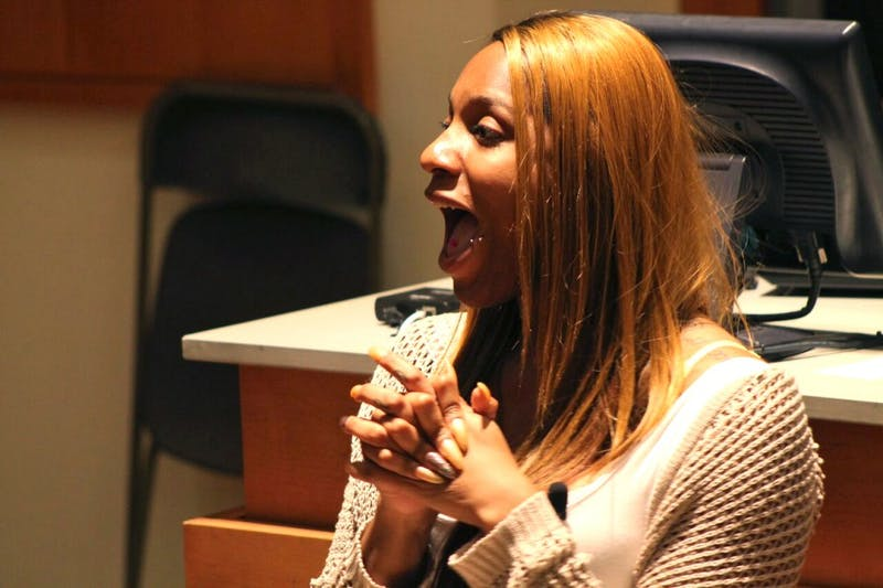 Activist CeCe McDonald answers a question posed by a member of student group the UNControllables. McDonald spoke to an audience at UNC about her work in prison abolition activism as well as her own experiences as a black transgender woman in prison.