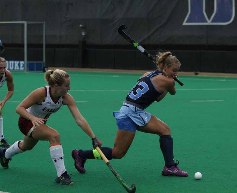 Junior midfielder Ashley Hoffman (13) rears back for a shot against Boston College on Sep. 16 in Durham.