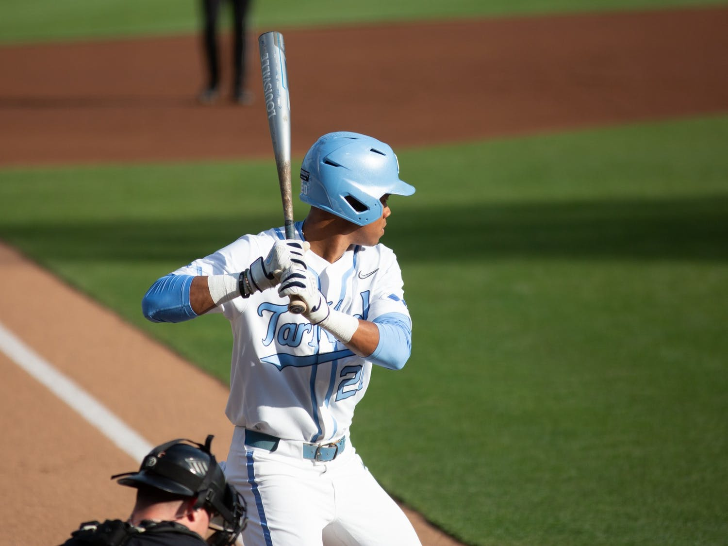 Sophomore outfielder Justice Thompson (20) stands at bat in a game against Louisville on Friday, May 14, 2021. The Tar Heels beat the Cardinals 5-1.