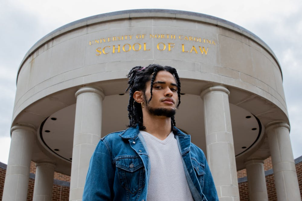 Zachary Boyce, a first-year law student poses for a portrait in front of the Law School. Boyce had racist comments directed towards him by a fellow law student via zoom chat during class.