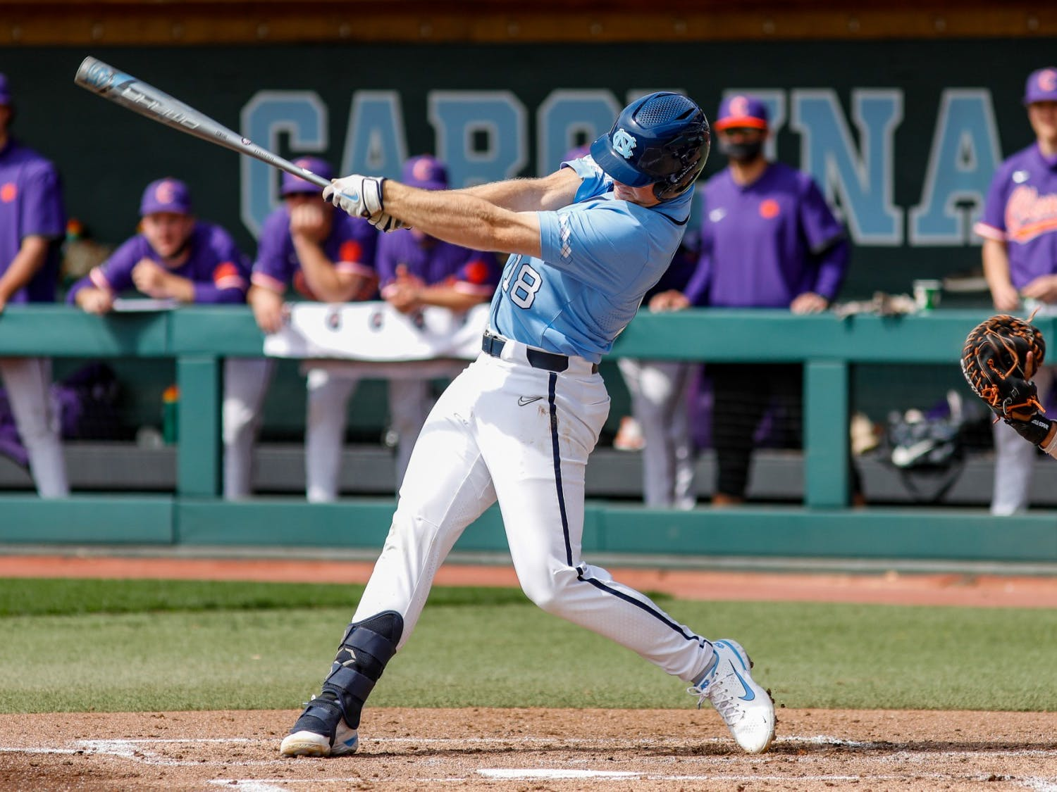 UNC junior Clemente Inclan (18) swings the bat in a game against Clemson University at Boshamer Stadium on Sunday, March 14, 2021. The Tar Heels beat the Tigers 5-3. Photo courtesy of Abe Loven.