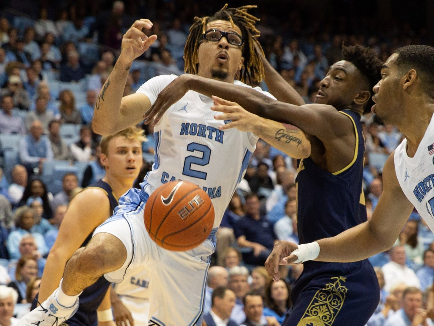UNC guard Leaky Black (1) is blocked by a Notre Dame player on Wednesday, Nov. 6th, 2019 at the Dean E. Smith Center. UNC beat Notre Dame 76-65.