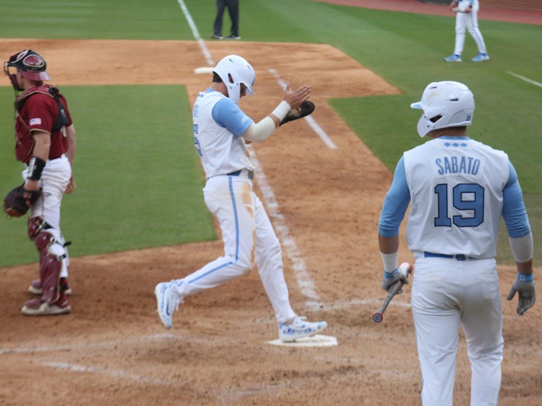 Junior Ashton McGee reaches home during the Tar Heels' third baseball game against Boston College on Easter weekend, 2019.