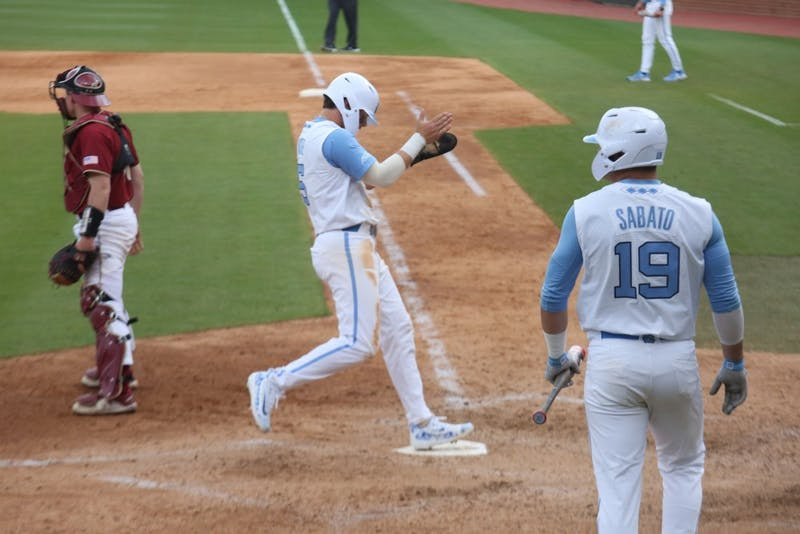Junior Ashton McGee reaches home during the Tar Heels' third baseball game against Boston College on Easter weekend, 2019.