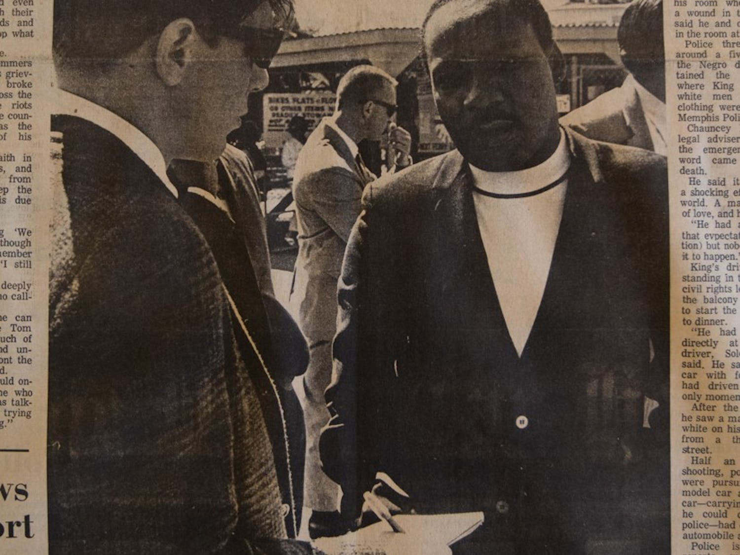 DTH File. Dr. Martin Luther King Jr. being interviewed by 1968 Daily Tar Heel editor Bill Amlong in the summer of 1967.