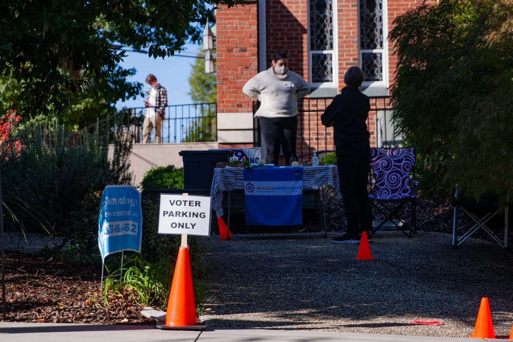 <p>Volunteers at the Holy Trinity Lutheran Church polling location take a break during some down time on Tuesday, Nov. 3, 2020.</p>