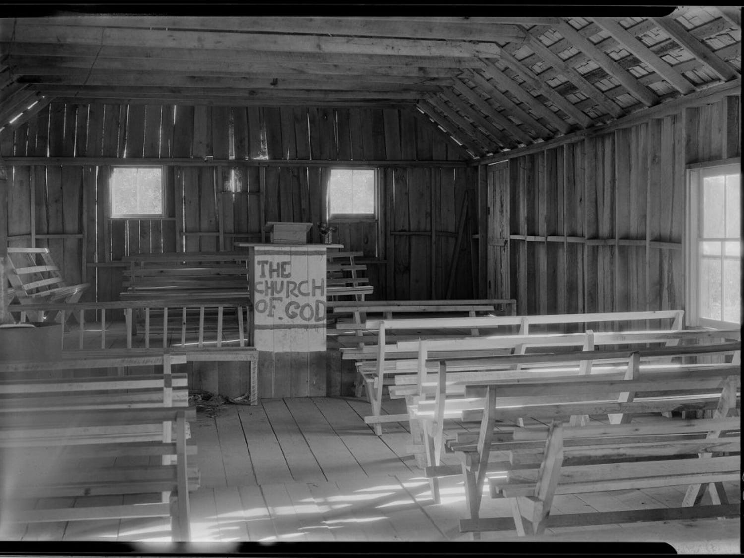 """""""The sinners will occupy the benches in the body of the church; the seats on the platform are for the Saints of Holiness."""" Photo by Bayard Wootten."""