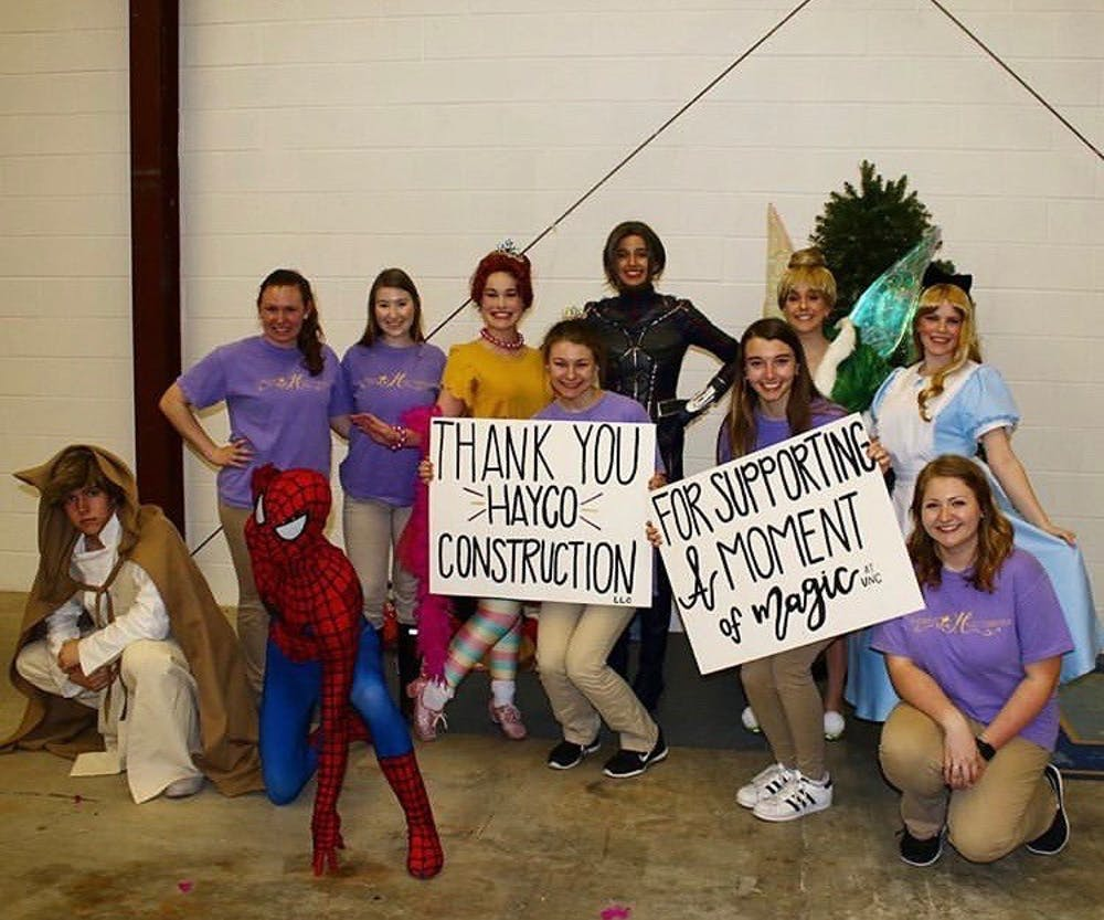 <p>Members of UNC's A Moment of Magic Foundation, through which UNC students work with ill children. Contributed by Travis Hayes.</p>
