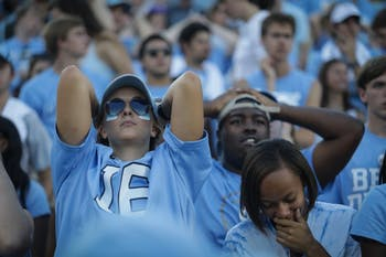 UNC fans react to the team's 27-17 loss to Duke on Saturday, Sept. 23, 2017 in Kenan Stadium.