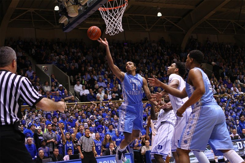 Junior forward Brice Johnson (11) shoots in the game against Duke at Cameron Indoor Stadium in Durham on Wednesday, Feb. 19.