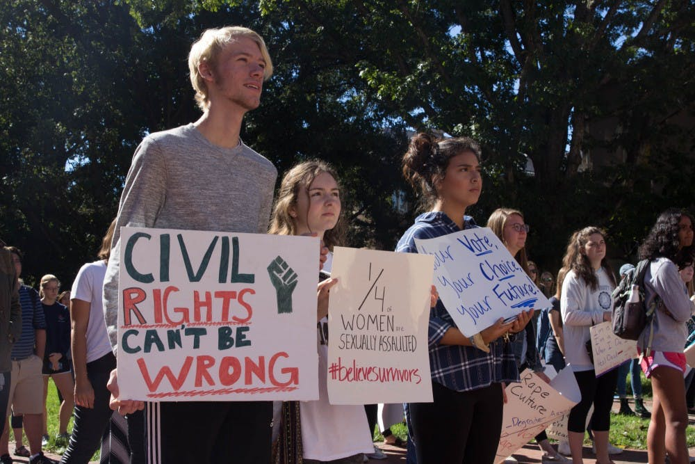 UNC students march to fraternity court for Believe Survivors rally