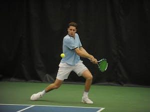 UNC tennis senior Blaine Boyden prepares to return the ball during a match against Bucknell University on Saturday, Jan. 19, 2019.
