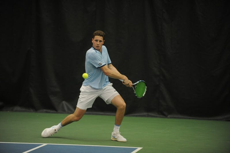 UNC tennis senior Blaine Boyden prepares to return the ball during a match against Bucknell University on Saturday, Jan. 19, 2019.