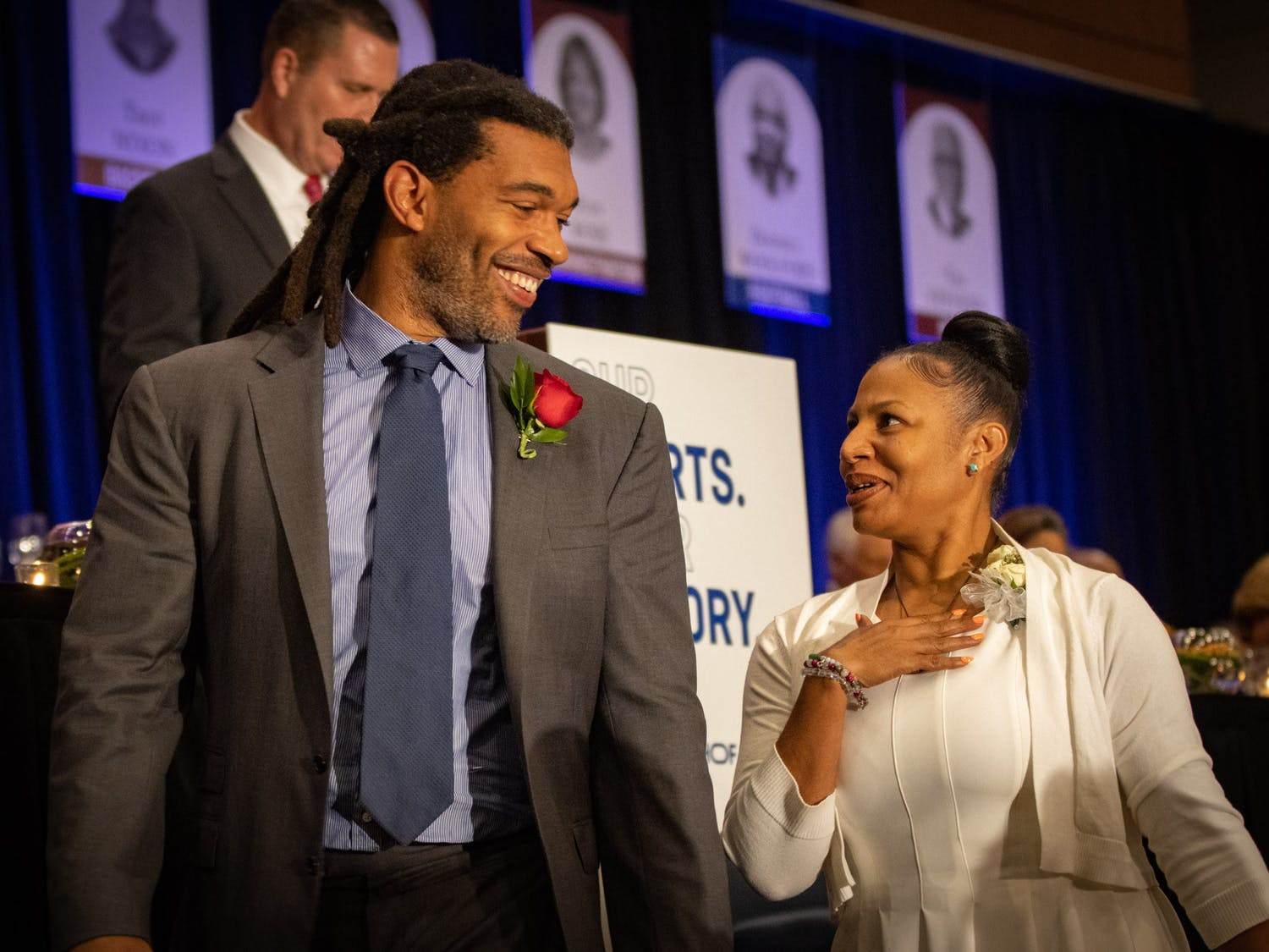 Inductee Julius Peppers shares a smile with his sister as he is introduced at the North Carolina Sports Hall of Fame induction ceremony Friday.