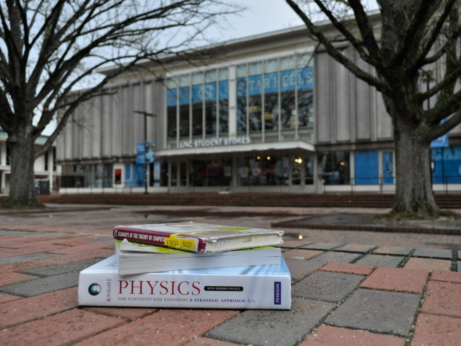 A stack of textbooks sits outside of UNC Student Stores on Tuesday, April 2, 2019.
