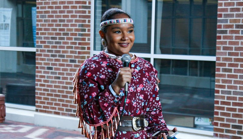 First-year nursing major and American Indian and Indigenous studies minor Taylor Williams speaks after performing during the Carolina Indian Circle's Indigenous Peoples Day celebration on Monday, Oct. 14, 2019.