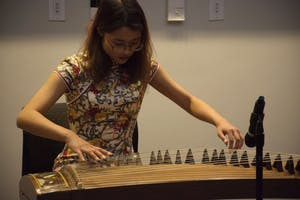 A woman performs zither music at Friday's 2018 Lunar Year Celebration. Photo courtesy of the Friendship Association of Chinese Students and Scholars.