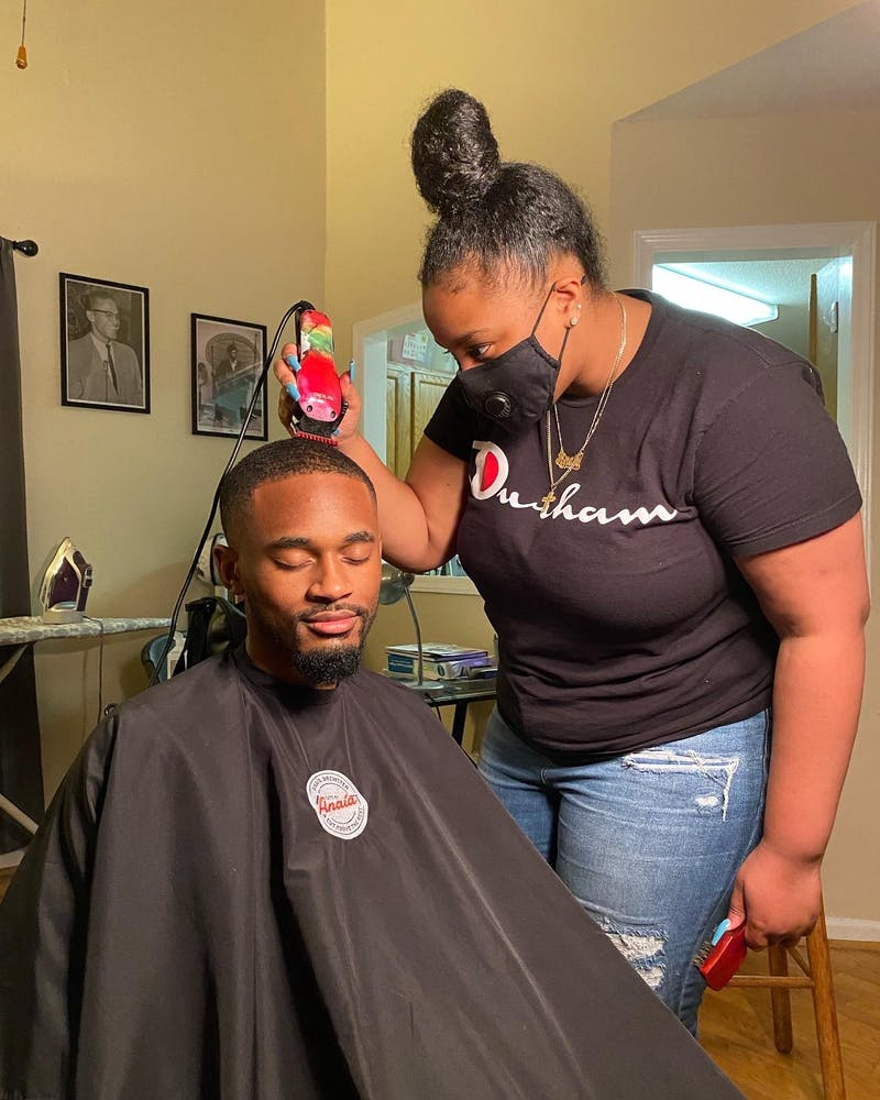 Anaía Brewster, a rising senior and hair stylist, started a business cutting hair amid the COVID-19 pandemic while many local barbershops were closed. Photo courtesy of Tamiya Troy .