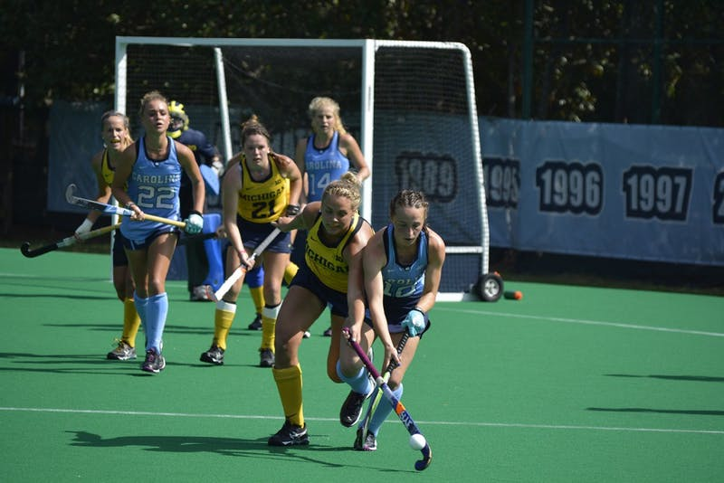 Eef Andriessen, First-year UNC Forward, fights for possession of the ball during the Tar Heels' Sunday victory over Michigan. The final score was 5-1.