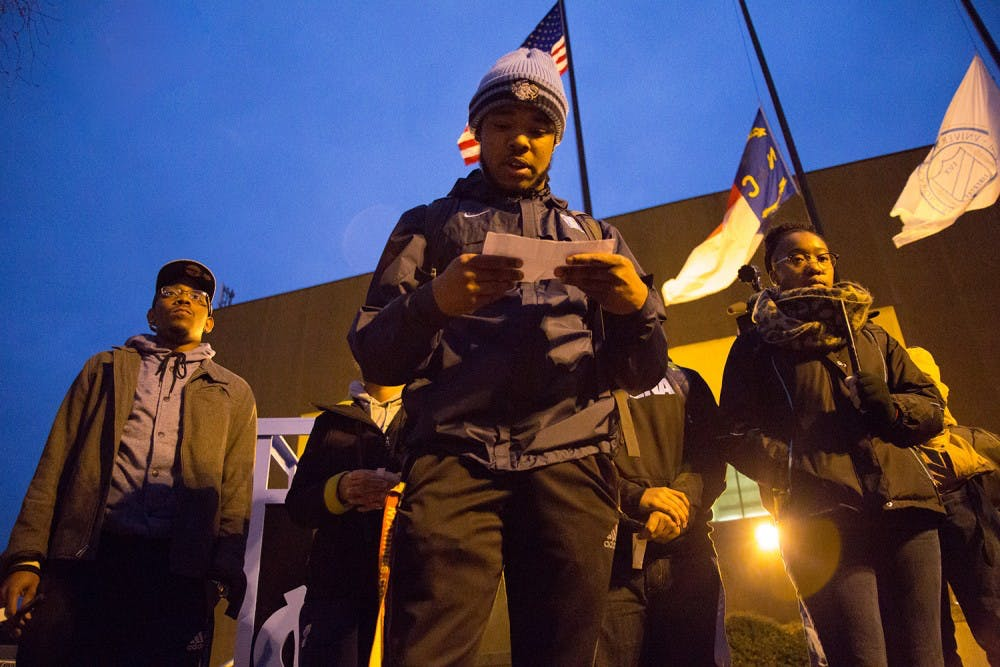 <p>Junior Michael Morrison speaks during a vigil to honor Coach Dean Smith held on Tuesday night at the Dean Dome by the UNC  NAACP.</p>