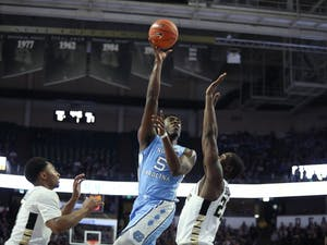 Wake Forest sophomore guard Chaundee Brown (23) attempts to block UNC first-year forward Nassir Little (5) during No. 8 UNC's 95-57 win over Wake Forest on Saturday, Feb. 16, 2019 at Lawrence Joel Veterans Memorial Coliseum.
