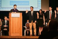 Junior Houston Summers taking his oath to office as UNC Student Body President for the 2015-2016 academic year in the Great Hall on Tuesday. He succeed former SBP Andrew Powell.