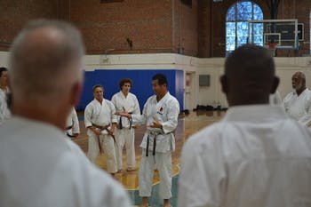 Sensai Nagatomo engages a diverse range of competitors at a UNC Shotokan Karate tournament Saturday afternoon.