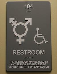 A gender non-specific bathroom sign hangs outside a Campus Y bathroom.