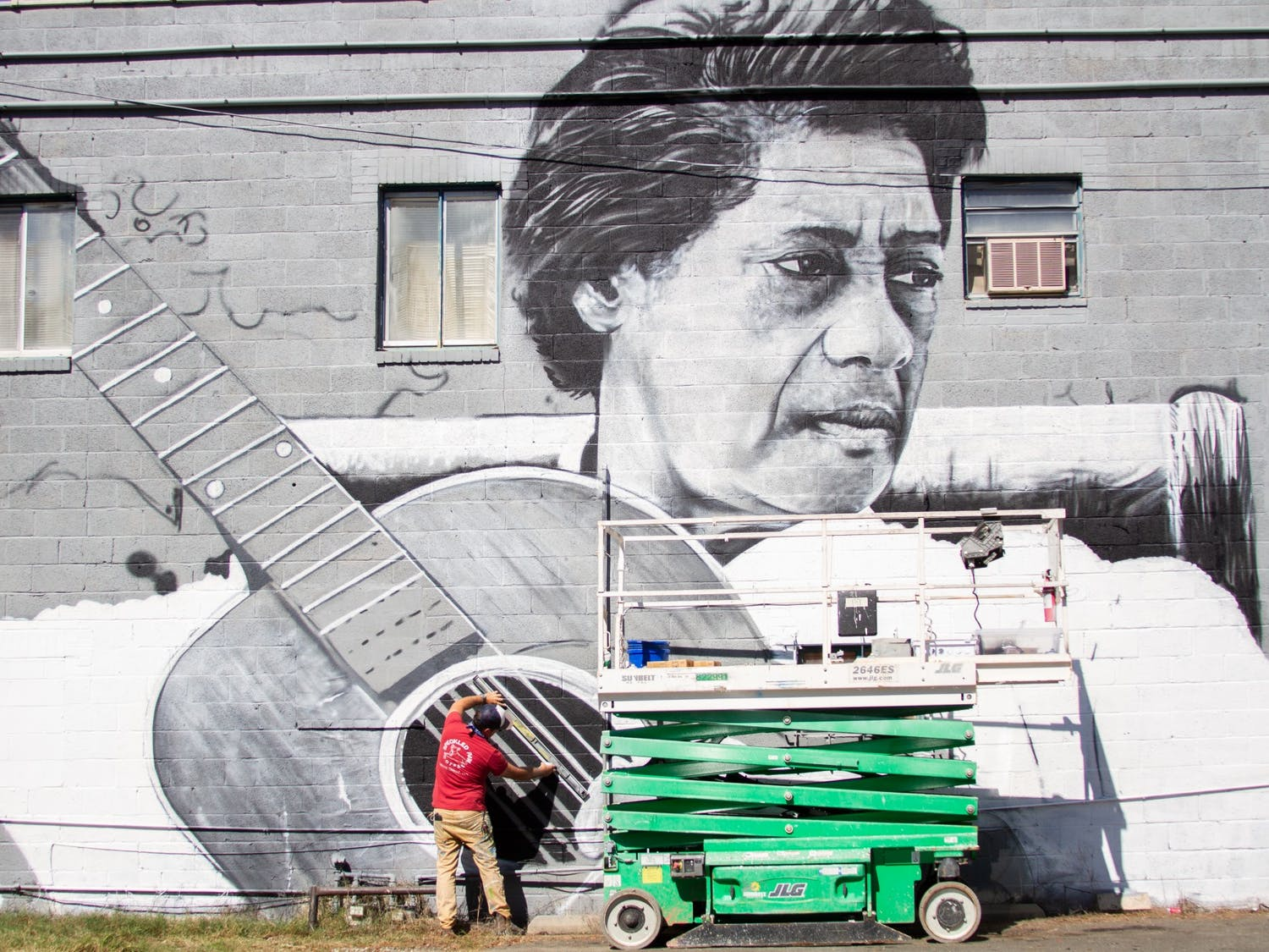 Muralist Scott Nurkin works on a mural of legendary blues musician Elizabeth Cotton on Merritt Mill Road on Wednesday, Oct. 14, 2020. This mural is part of a wider effort called the North Carolina Musicians Mural Project.