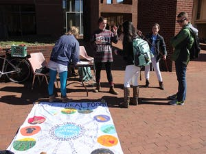 Members of UNC Real Food Challenge talked to students about what Real Food is and the group's goals for the semester in Davis Courtyard on Wednesday.