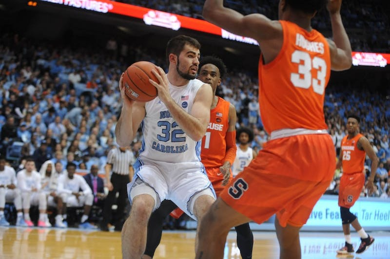 Senior forward Luke Maye (32) looks to pass against Syracuse on Tuesday, Feb. 26, in the Smith Center. UNC defeated Syracuse, 93-85