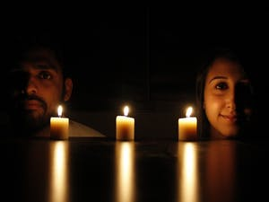 Imad Ahmad (left), Deah's best friend and roommate, and Lina Chaarawi, Yusor and Razan's cousin, pose in front of candles for each of Our Three Winners.
