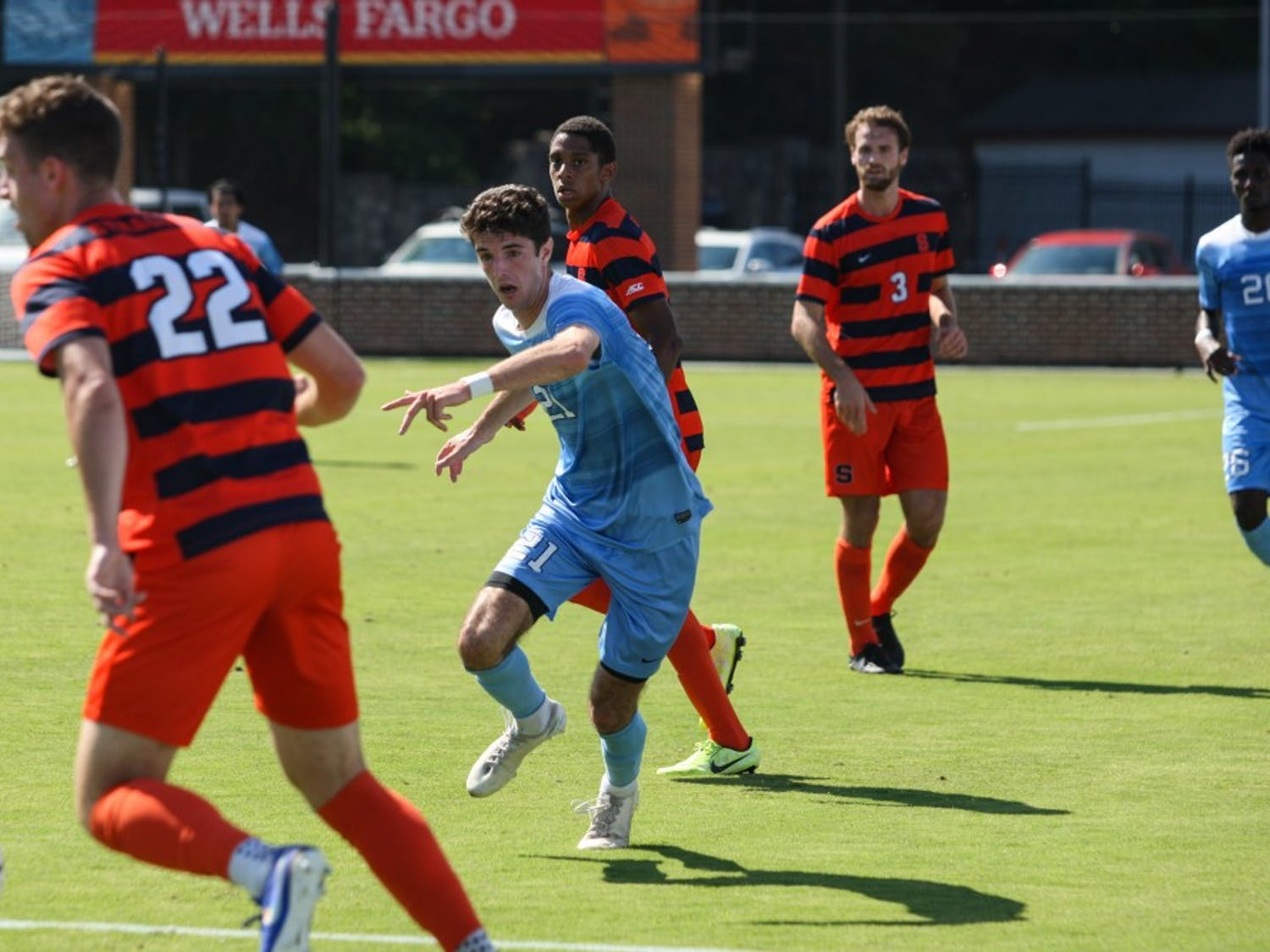 Junior forward Alex Rose (21) runs after the ball during a game against Syracuse at Dorrance Field on Saturday, Oct. 12, 2019. The Tar Heels lost 3-4.