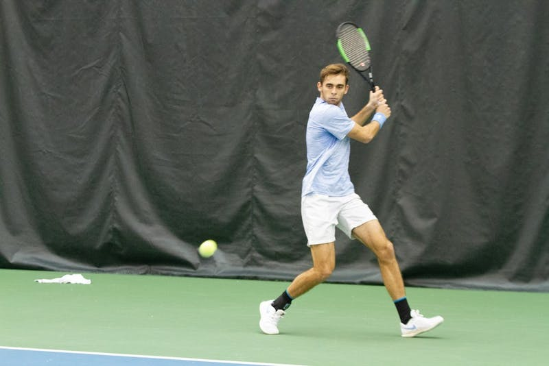 UNC Junior Benjamin Sigouin prepares to return the ball to Georgia State Roberts Grinvalds in the Cone-Kenfield Tennis Center on Sunday, Jan. 26, 2020. The Tar Heels won 4-0.