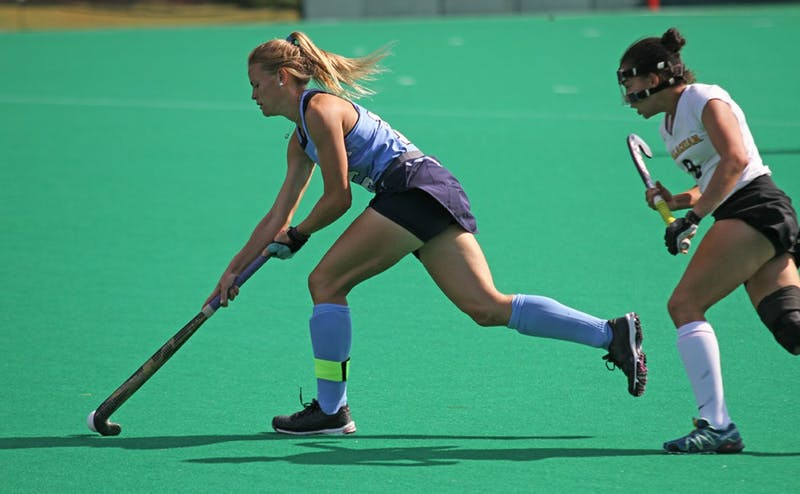 Senior back Julia Young (16) moves the ball upfield against Appalachian State on October 30.