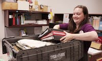The Chapel Hill Public Library will move to University Mall beginning Oct. 30. Library assistant Beth Wright moves boxes that contain programming and work office contents.
