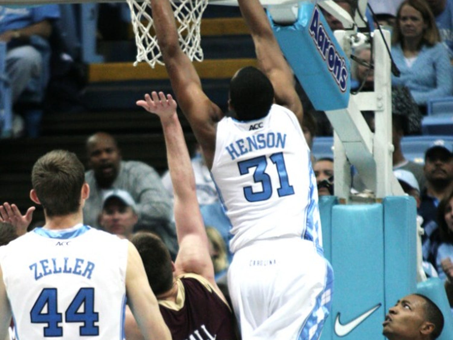 North Carolina's John Henson goes up for a block against Charleston. The Tar Heels have won four consecutive ACC/Big Ten Challenge games.