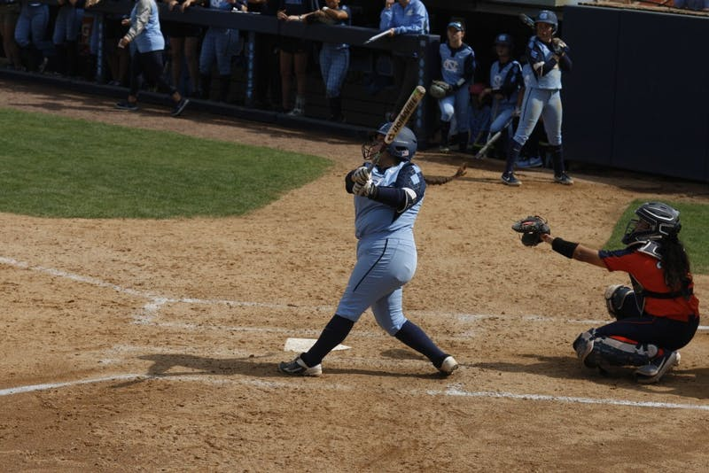 Senior third baseman Berlynne Delamora (27) hits the ball during UNC's double header against the University of Virginia. The Tar Heels won both games 8-0 at the G. Anderson Softball Stadium on Sunday, Apr. 7, 2019.
