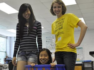 Yuaing Chen, Anna Li and Kristen Powers from the Green Tigers decorated recycling bins during the Green Your School Challenge.