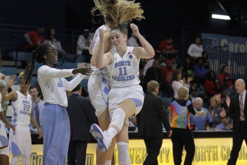 Sophomore Emily Sullivan (11) celebrates with her teammates in North Carolina's win over Radford in Carmichael Arena.